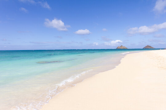 White sand tranquil beach with turquoise sea on exotic tropical island