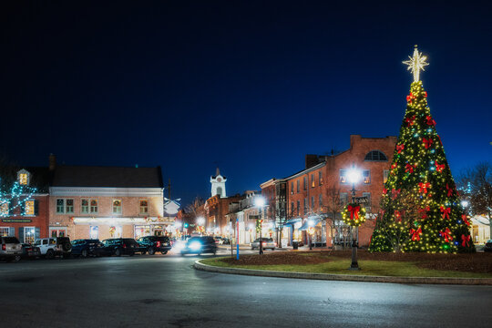 Decorated Christmas tree lit up at night with a star in the quaint village town square of historic Gettysburg, Pennsylvania. Winter holiday scenic.