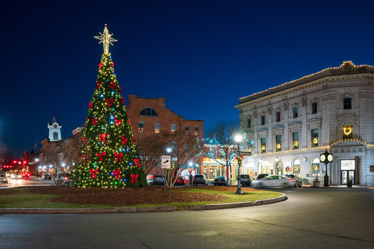 Historic town square with holiday tree lit up at night at Christmas, Gettysburg, Pennsylvania. Winter travel and tourism.