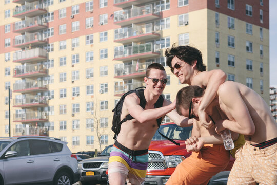 Young Men Friends Horsing Around on a Hot Summer Day in Rockaway Beach