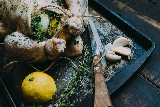 Lemon, Thyme and Garlic Stuffed Raw Rotisserie Chicken on a Tray