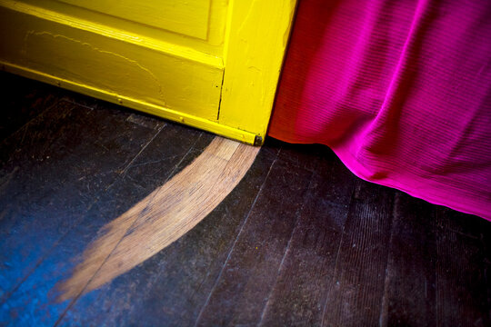 Hardwood floor with Groove in it from Door