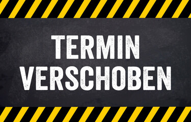 Black chalkboard with the german words for This event is postponed - Termin Event verschoben
