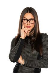 beautifu thinkingl young woman with glasses
