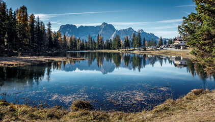 Wonderful Autumn scenery of mountains. The landscape around lake Antorno in Dolomites Alps in sunny day. Stunning natural background. Popular travel and hiking place. Amazing nature in World