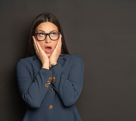 Attractive shocked business woman in blue suit