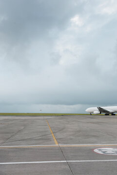 Jet airliner taxiing for take off on a remote island airport. Storm coming up.