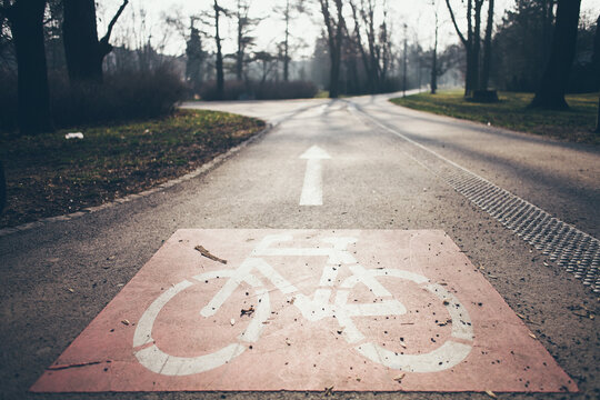 Bicycle road sign on the ground