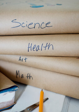 Homemade book covers with school classes written on spine