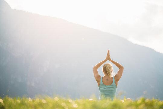 Woman doing yoga, Lord of the Dance Pose (Natarajasana)