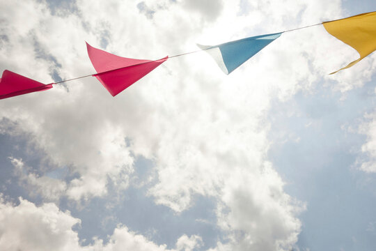 Festive colorful flags / banners against sky