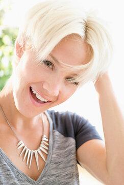 Portrait of blonde woman wearing necklace