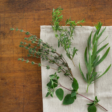 Variation of herbs on table