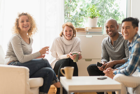 Group of friends hanging out in living room