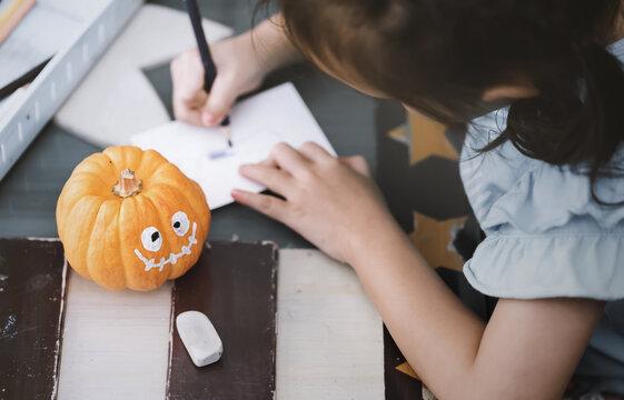 Preparation for autumn decor.Pumpkin ghost of Halloween.Halloween concept background.