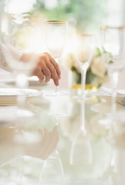 Close up of man's hand setting place in restaurant