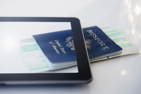 Digital tablet, airplane tickets and passport