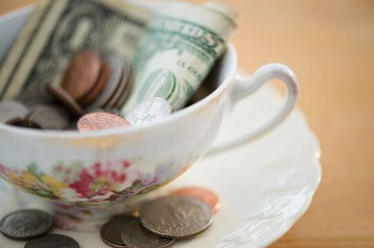 Studio shot of money in tea cup