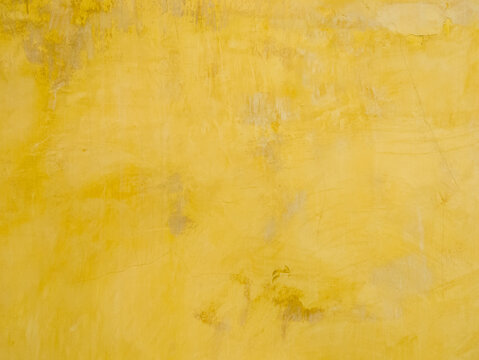 Background of the old yellow wall with the stained.