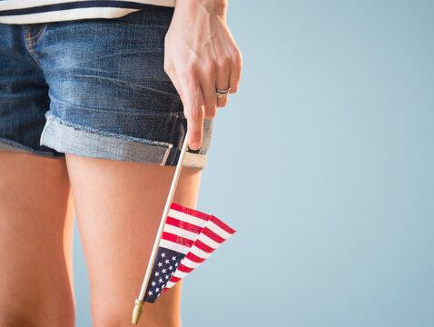 Studio shot of woman's hand holding American flag