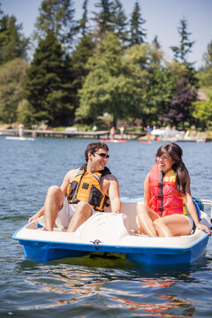Young man and woman on paddle boat