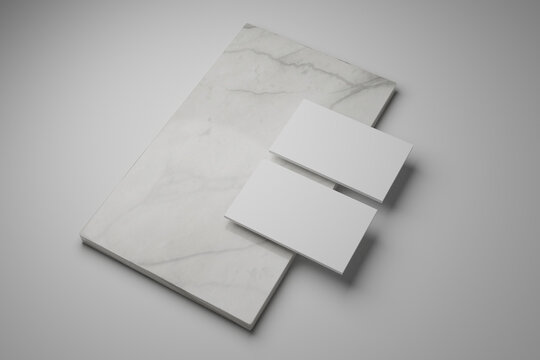Business card mock ups isolated on white marble background.