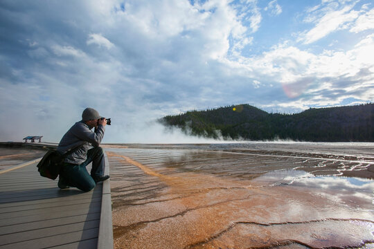 Man photographing Grand Prismatic Geyser