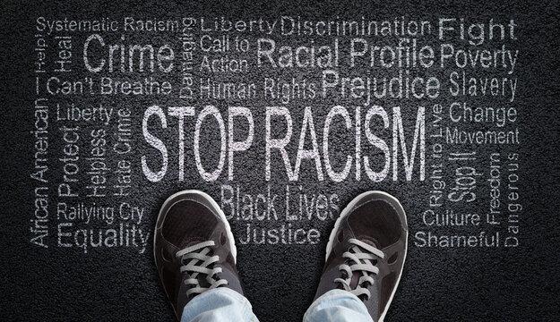 Stop Racism Word Cloud on Asphalt Concept of Fighting Discrimination