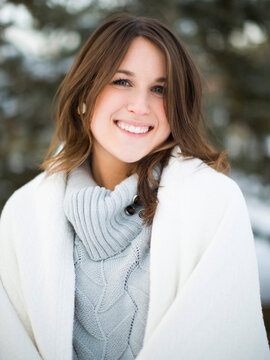 Portrait of woman smiling outdoors