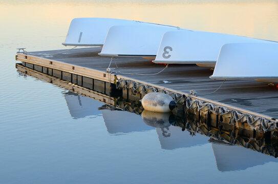 Overturned boats resting on dock