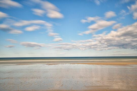 Sandy beach in water, horizon over sea