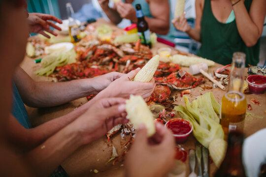 Friends enjoying a crab feast in Maryland