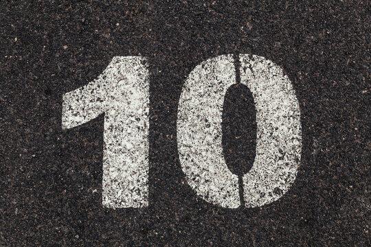 Number 10 Printed on White Over Dirty Asphalt