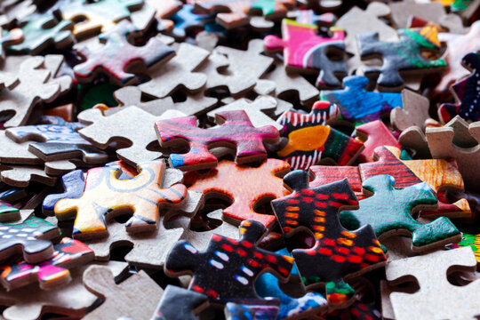 Disassembled puzzle colored pieces