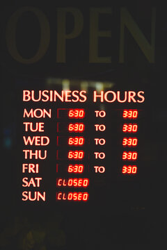 Business hours sign in downtown Vancouver, Canada