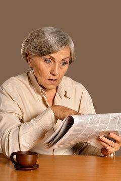 Portrait of a senior woman reading newspaper