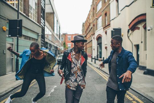 Three people having fun in an urban street