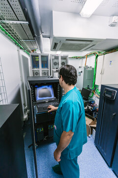 Assistant Checking the Servers of the Surgery Robotic Equipment
