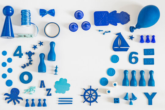 Collection of blue toys and game pieces