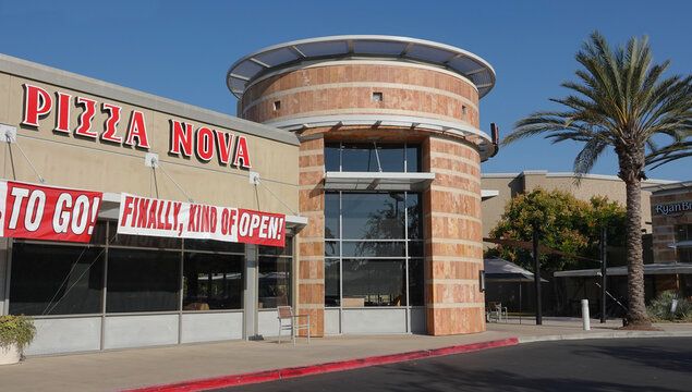 San Marcos, CA / USA - September 24, 2020: Humorous reopening sign on Pizza Nova store, after much back and forth with California restrictions