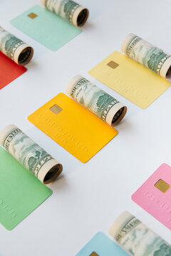Concept for finance : dollar rolls and colorful credit cards