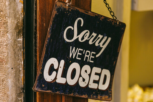Sorry We are Closed Sign on a Shop Entrance