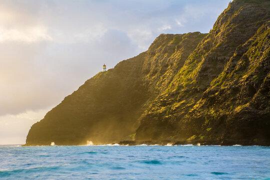 Lighthouse on cliff at Makapuu sunrise / sunset on Oahu, Hawaii