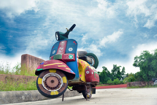 Traditional painted scooter landscape background .
