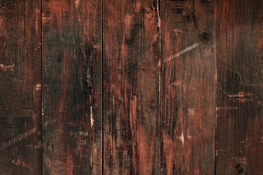Dark stained wood panel background