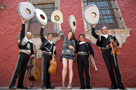 Female tourist with Mariachi Band. Mexico