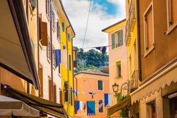 Beautiful colored hous facades in the narrow streets in Garda