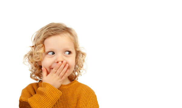 Shy funny child covering his mouth