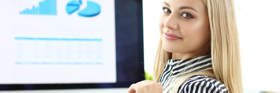 Beautiful girl workplace finance manager, office. Skills and qualities necessary for successful office worker. Office worker is free to use office programs. Employee training, continuing education.