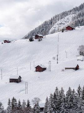 Scenic view of houses in Ursern Valley during winter